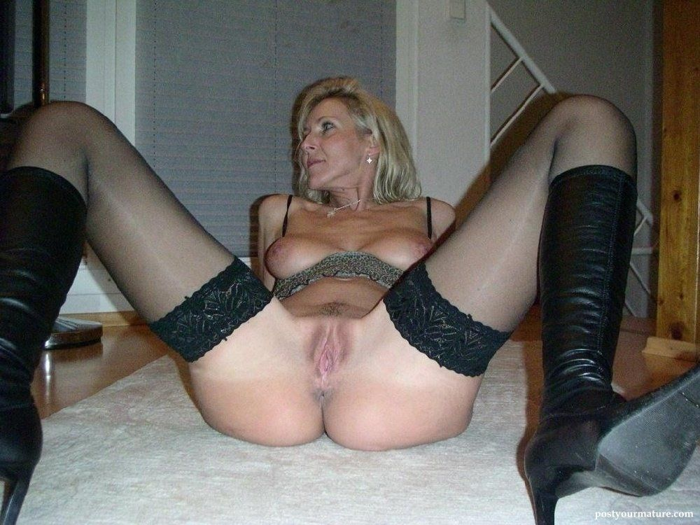 Spread pics mature Category:Nude women